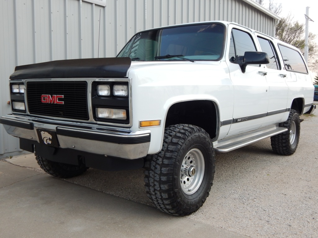 Watch also File 1st Cadillac Escalade together with 400187116859442595 likewise Clint Silver 1990 Gmc Suburban 001 1 in addition 1999 Ford F 250 6 Door Excursion Monster 40 Tires Stunning Custom. on 1990 lifted chevy